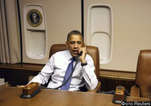 U.S. President Obama places calls to campaign national volunteer leaders on his way to Los Angeles, on board Air Force One